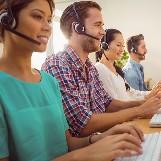 shutterstock_292634966-customer-service-team-in-modern-office-compressed