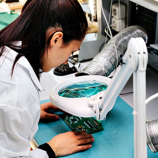 shutterstock_521430211-woman-performs-quality-control-testing-on-PCB-under-magnifying-glass-compressed (1)